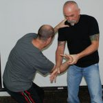 Levi Montgomery training a student in joint manipulation.